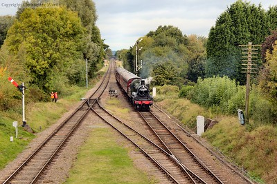 The Ivatt 2MT approaches with a local train