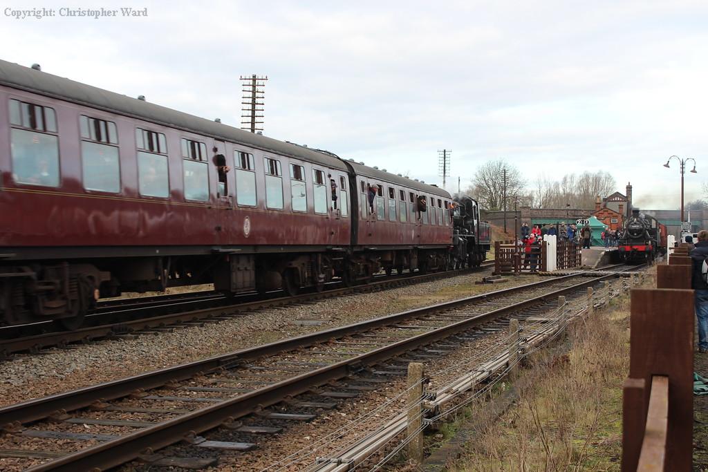 78019 runs into Quorn & Woodhouse as the Ivatt 2MT runs through