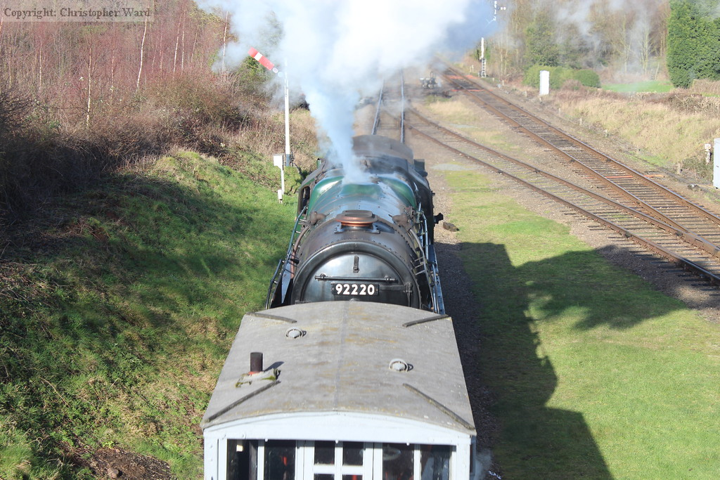 92214 peeps over the top of the brake van as she takes the windcutters back north