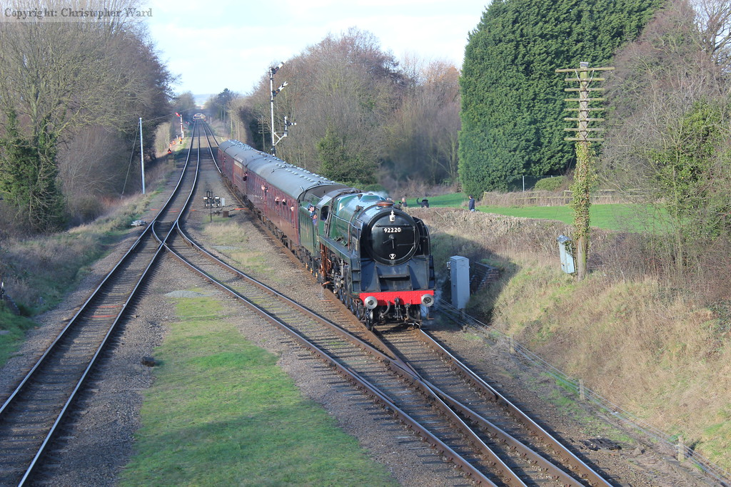 The sun ducks behind a cloud as the 9F slows for Quorn with a Leicester North working