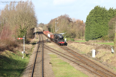 The 8F passes the impressive signal gantry to the south of Quorn with a mixed goods working