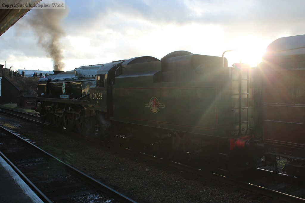 The sun peeks through as 34053 waits for the right away at Loughborough