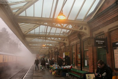 The smoke from a light engine move through the station hangs in the canopy on a damp morning, giving a wonderful atmosphere