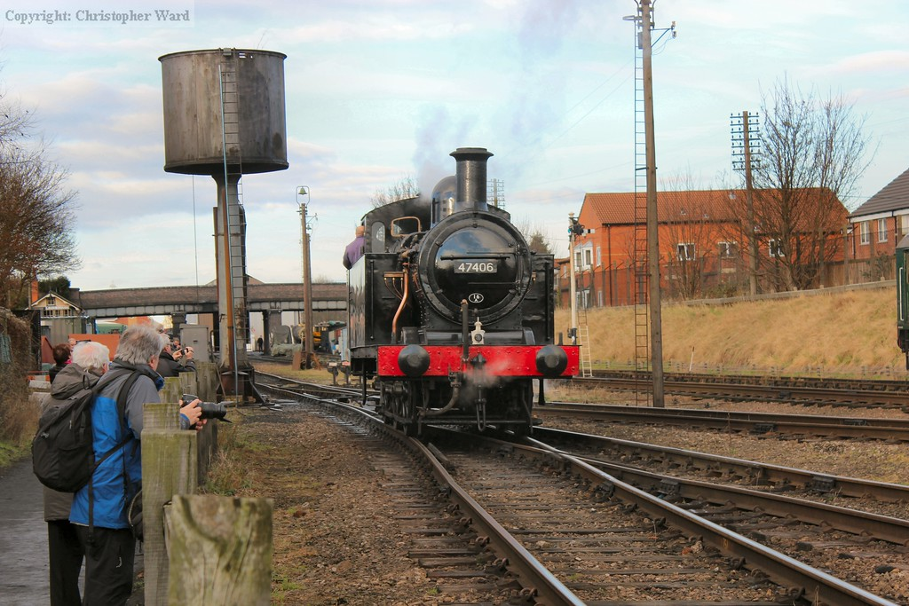 The Jinty drops off the mixed freight set and back into the yard for servicing
