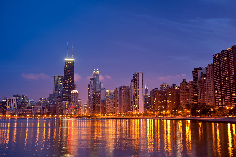 Chicago lakefront skyline from north, looking south along Lake Shore Drive as the sun sets