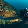 Technical diver on the bow of the schooner Dunderberg