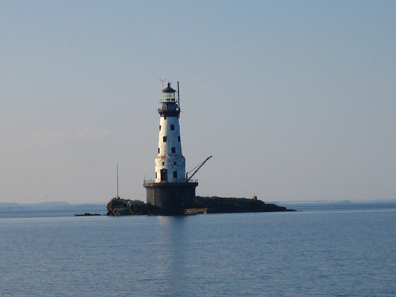 Rock of Ages lighthouse (a past calm day) marks the reef which claimed 3 ships that are here: Chisholm, Cumberland and Cox.