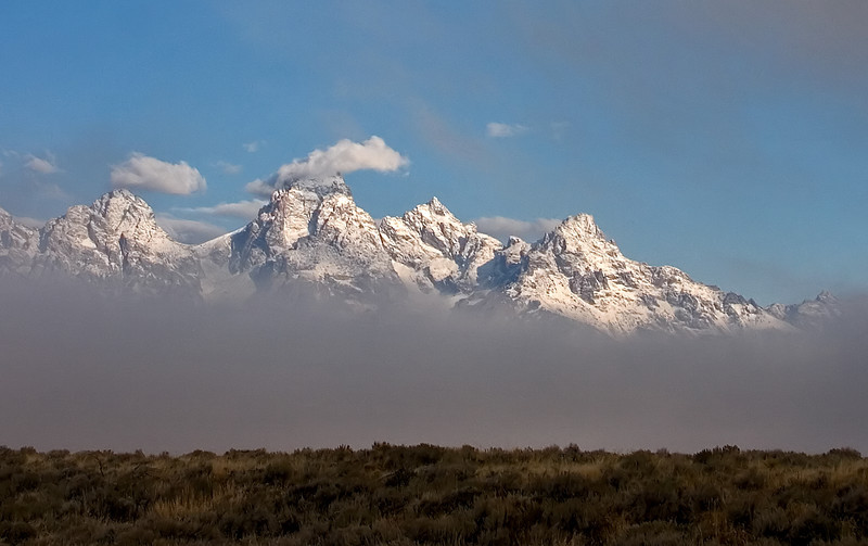 Early morning and the Tetons were drifting in and out of the mist.  This was shot from Mormon Row.