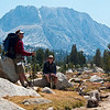 John and Chris take a break, with Fletcher Peak in background. The camp is at the right base of Fletcher Peak. Smoke from the western park fires takes over the background.<br /> <br /> <br /> Day 1 - Tuolumne Meadows Lodge to Vogelsang camp.