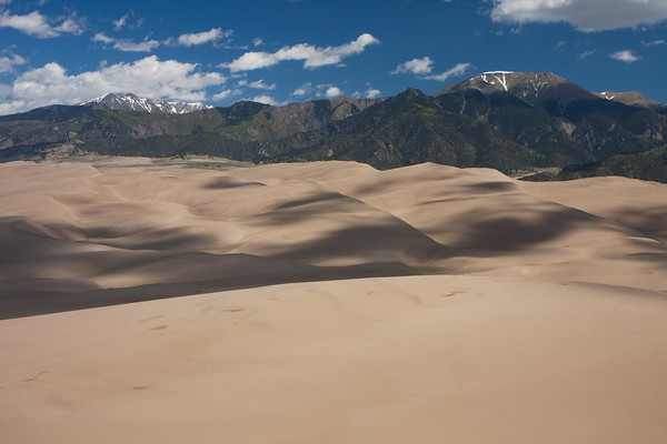 Once I reached the ridgeline, I was rewarded with views of never-ending dunes and the Sangre de Cristo mountains to the North. Mt Herard is the tallest peak on the right, and dominates the scene at Great Sand Dunes National Park.