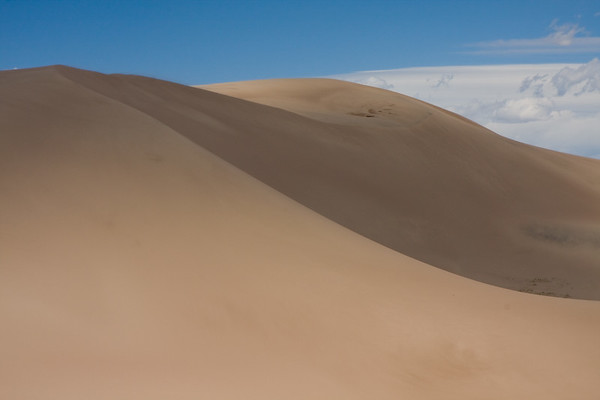 One of the many lonely dunes that I walked past on my way up to the ridgeline. These dunes are constantly changing from the wind...The lines created from the wind are spectacular, and I realized when looking at this dune that I could spend days just wandering through this area.