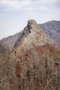 chimney tops with two people climbing the side of it