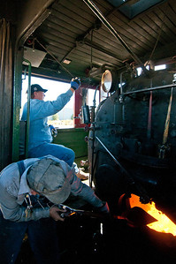 Sandy mans the locomotive bell heading into East Ely, as Levi Garcia, Nevada Northern fireman, touches up # 40's fire.