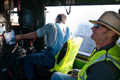 UP pilot engineer Denver McCrory enjoys 844's smooth ride. UP steam engineer Ed Dickens Jr., hand on the independent brake, peers ahead through the steam.