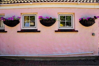 Pink building with square windows;  Guernsey Island