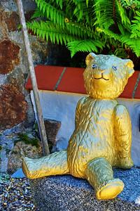 Golden teddy bear at a goldsmith shop