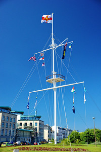 Harbor Mast to honor the liberation of Guernsey Island from the Nazi.  The Guernsey Island flag is at the top.