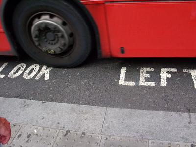 """A reminder for visiting tourists to """"Look Left"""" or get run over by a big red bus."""
