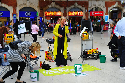 Victoria Station opera singer performing for donations to fight cancer  London, England
