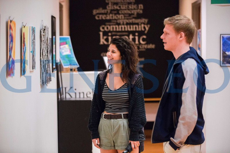 Julia Mintz '19 and Joseph Strassfueld '19 take in the GREAT Battle of the Artists show.