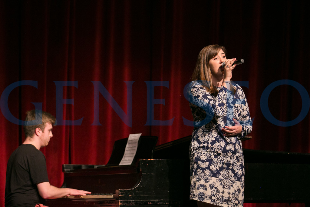Sarah Bissell and Michael Masetta perform the alma mater before the start of Dr. Erich jarvis' keynote address.