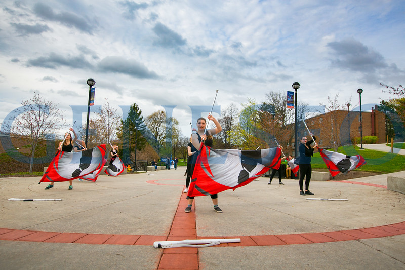 Geneseo's Saphire Winter Guard performs outside the Union.