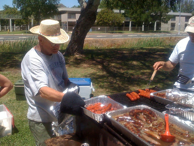 While folks are arriving and setting up to relax, our Picnic Host, Ron Imig, is already busy barbecuing Cooking up Bratwurst and Sauerkraut, Hot Dogs,  Hamburgers, Chicken breasts and baked beans.  Also plenty of fresh salads.   Fantastic job Ron!