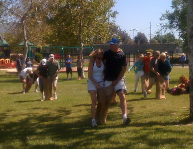 Sue and Greg take an early lead in the three legged race.  Julianne works on getting her partner back on her feet..