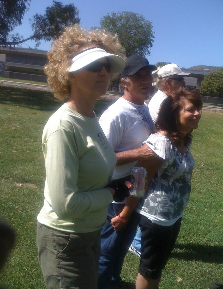 Nancy leads the onlookers in cheering on their favorites.