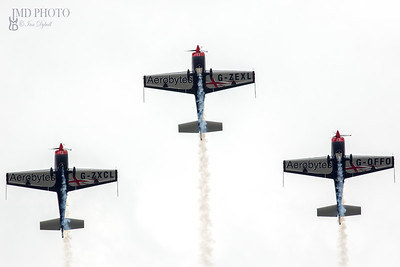 The Blades aerobatic display team performing advanced aerial acrobatics in Extra EA-300 aeroplanes