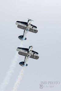 Wildcats aerobatic display team flying Pitts Special aircraft with trailing smoke at the free Great Yarmouth  airshow