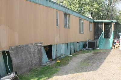 09 03 Minden, LA -  The obvious needs are for a new skirt and accessibiltiy ramp. lf