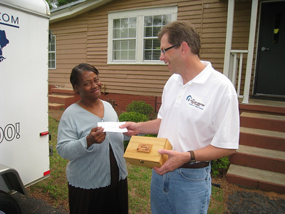 2009 05-14  Greater Blessings homeowner presents a check to Kirk Lyman-Barner so other homeowners can be blessed with badly needed home improvements. staff photo