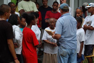 2008 07-19 Atlanta, GA - Mark Galey of Fuller Center Atlanta presents a Greater Blessings Box to Mrs. Bailey.