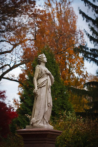 A statue of a woman marks a grave site in Mount Auburn Cemetery.