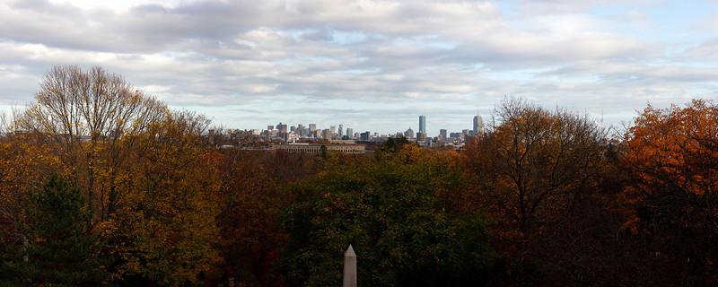 A panorama of ten individual photos, showing downtown Boston and Cambridge from Mount Auburn Cemetery.