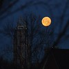 full moon, Cincinnati, 3-9-12<br /> <br /> It pays to have a camera with you. Saw this on the way to work Friday (3-9-12) and took advantage of a few minutes I had to spare. Not as sharp as I would have liked--not my best camera and glass, and no tripod--but still, a pretty awesome sight!