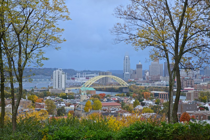 The City in Autumn.  A view of Cincinnati, Ohio, in autumn, framed by trees, from atop a hill in Northern Kentucky.