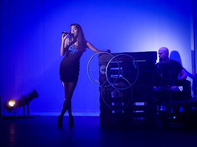 Singer at a piano singing.