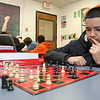 Greater Lowell Boys and Girls Club youth of the year Jeremy Encarnacion thinks about his next move in a chess match against Learning coordinator Marun Roldan on Friday at the club. SUN/JOHN LOVE