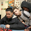 Greater Lowell Boys and Girls Club youth of the year Jeremy Encarnacion gets harassed by his friends Luis Lopez, 13, and Donte Fogle, 17, as he plays some chess at the club on Friday afternoon. SUN/JOHN LOVE