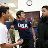 Greater Lowell Boys and Girls Club youth of the year Jeremy Encarnacion, on right,  chats with his friends at the club Anthony Villo, white shirt, Adrian Phonchanh, and Devan Long, USA shirt. SUN/JOHN LOVE