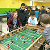 Greater Lowell Boys and Girls Club youth of the year Jeremy Encarnacion works with some of the younger club members on Friday afternoon. SUN/JOHN LOVE