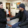 Greater Lowell Boys and Girls Club youth of the year Jeremy Encarnacion gets congratulated for being youth of the year from Learning coordinator Marun Roldan at the club on Friday afternoon. SUN/JOHN LOVE