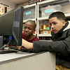 Greater Lowell Boys and Girls Club youth of the year Jeremy Encarnacion plays a video game with Shamarii Perry, 8, on Friday at the club. SUN/JOHN LOVE