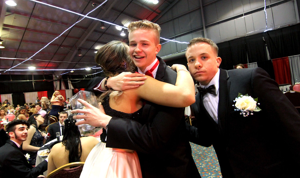 . Let the hugs begin at the Greater Lowell Tech Prom night at the Boxboro Regency. SUN/David H. Brow