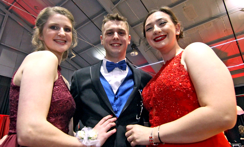 Friends at the Greater Lowell Tech Prom L-R, Jenna Cushion 18, Jonathan Bell 18 and Nicole Helms 17. SUN/David H. Brow