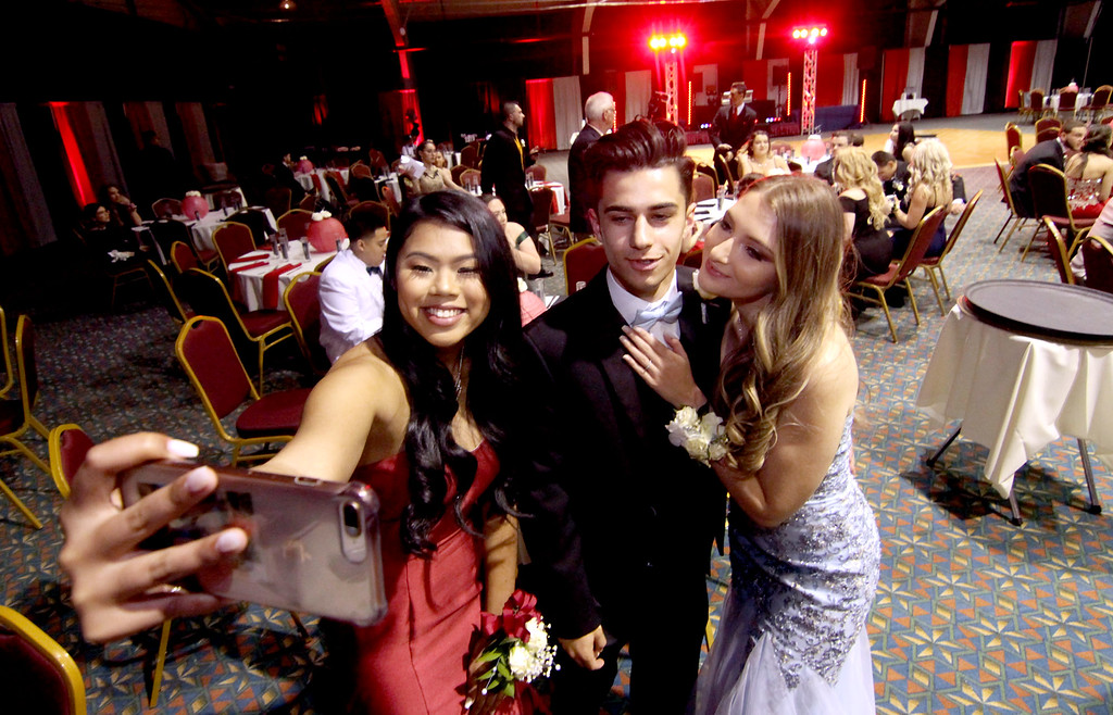 . Gearing for the night of the Greater Lowell Tech Prom is L-R, Serena Le 18, John Correia 17 of Wakefield, and his date Karen Tobon 17. SUN/David H. Brow