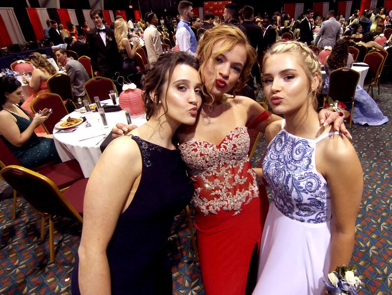 Friends Kendra Marsh 17, Elizabeth Ashton 18 and Katelin Willson 17 at Greater Lowell Tech Prom. SUN/David H. Brow