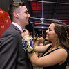 Greater Lowell Tech student RJ Patterson 18 of Dracut, gets a little help from his date Kiara Muca 18 of Haverhill at the GLT Prom in Boxboro. SUN/David H. Brow